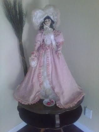 doll in long pink dress