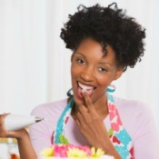 Woman Enjoying Cake Decorating