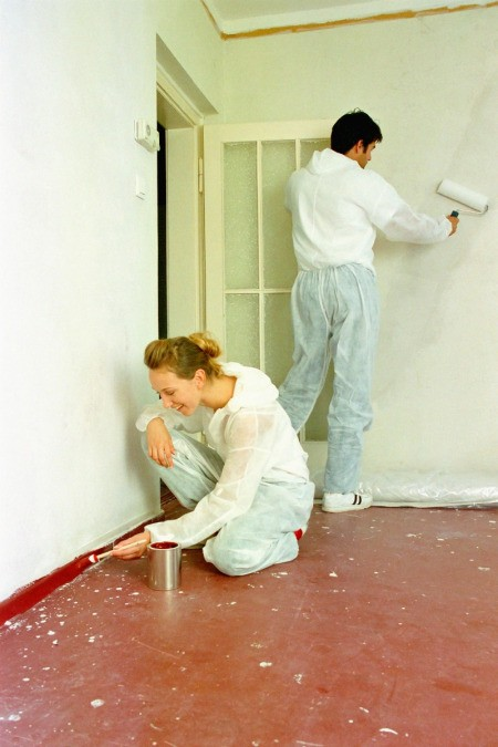 Couple Painting a Room Quickly