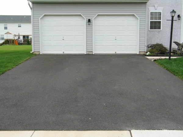 Cleaning tarmac thriftyfun for Best way to remove oil from concrete driveway