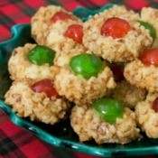 plate of cherry topped cookies