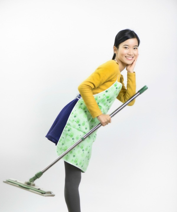 young woman holding a Swiffer style mop