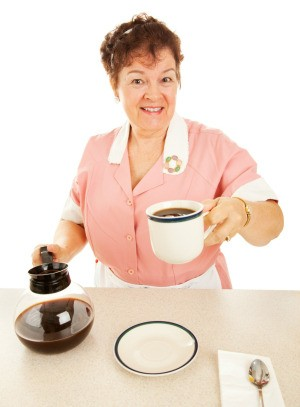 hot coffee pot placed on counter by waitress