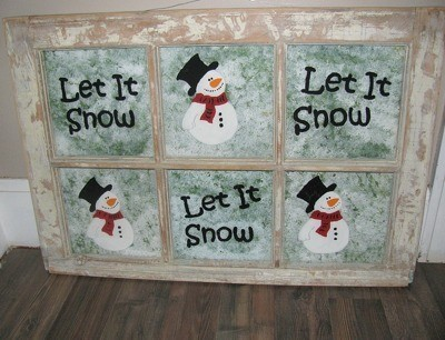 old window decorated with snowmen painted on the panes