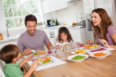 Family Eating Together Using Placemats