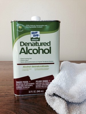 can of denatured alcohol and terrycloth rag