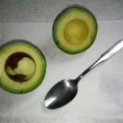 split avocado with seed still in place