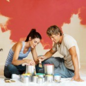 Couple Painting Each Room a Different Color