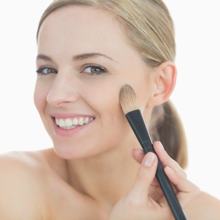Woman Applying Foundation Makeup