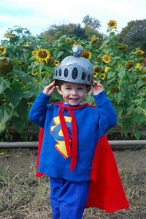 little boy dressed as Super Grover