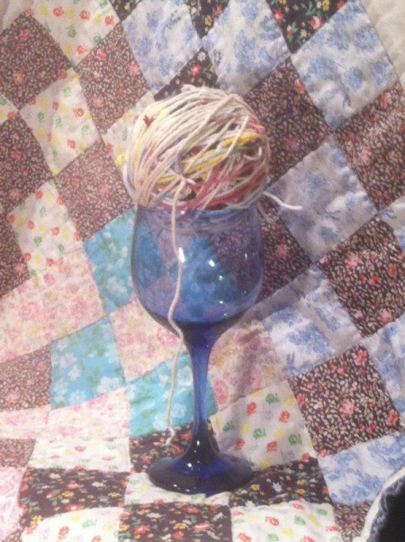 Scrap Yarn Ball - ball of yarn in stem glass