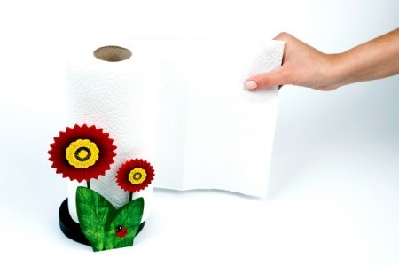 paper towel being pulled off cute flower holder
