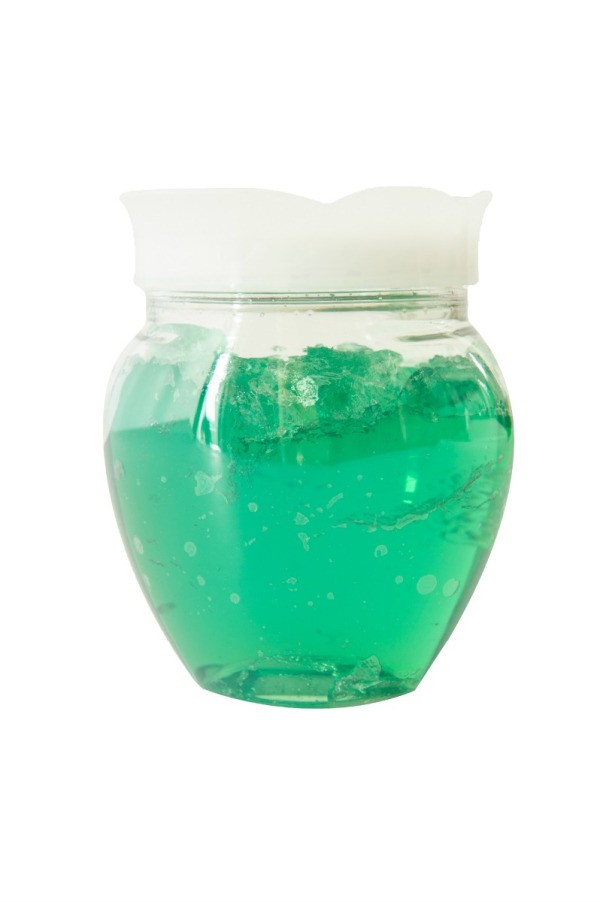 glass jar with green transparent deodorizer