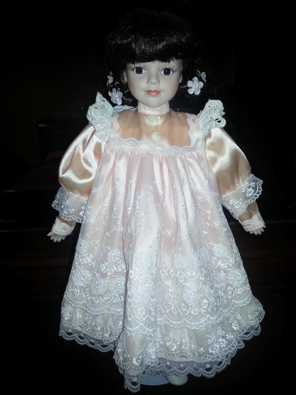 doll wearing pinafore dress