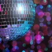 disco ball with colored lights behind