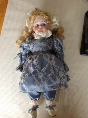 doll in blue dress
