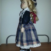 side view of doll in plaid dress