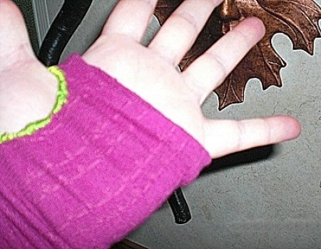 hand with sock arm warmer
