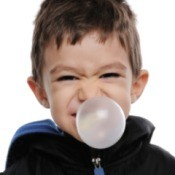 young boy blowing huge bubble
