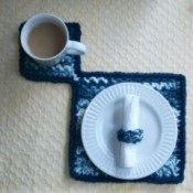 blue and white ombre crochet mat with cup and small plate