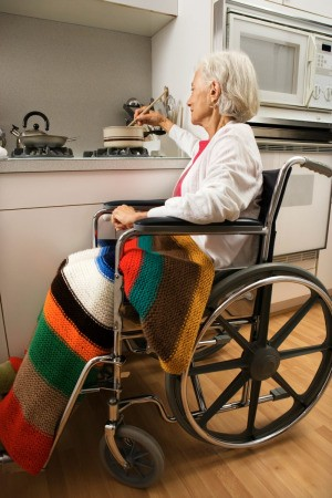 woman in wheelchair with afghan