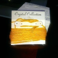 gold floss wrapped around card