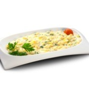 potatoes with cream and cheese on white platter with garnish