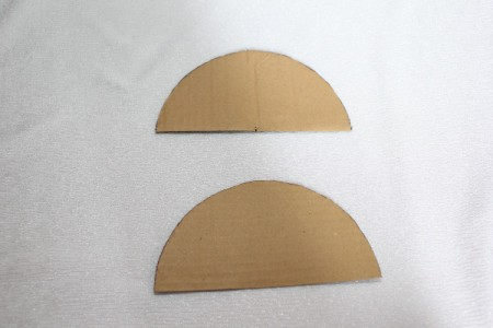 two matching cardboard parts