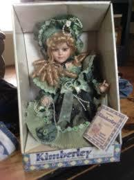 doll in green dress in box