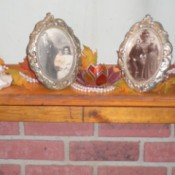 photos and decorations on mantle