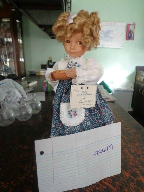 doll with Shirley Temple style curls