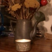 Finished candle holder with lighted candle.