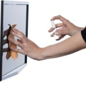 woman's hand cleaning a monitor