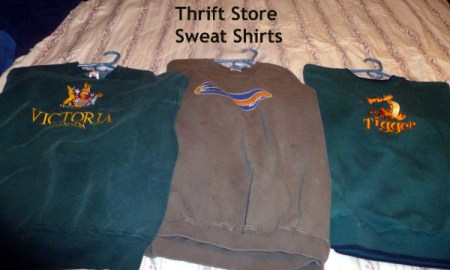 Three sweatshirts purchased at the thrift store.