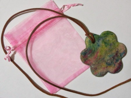 finished pendant on pink gift bag