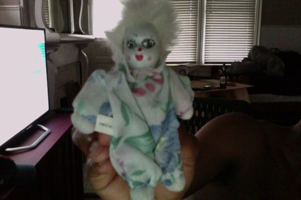 clown doll wearing blue and green
