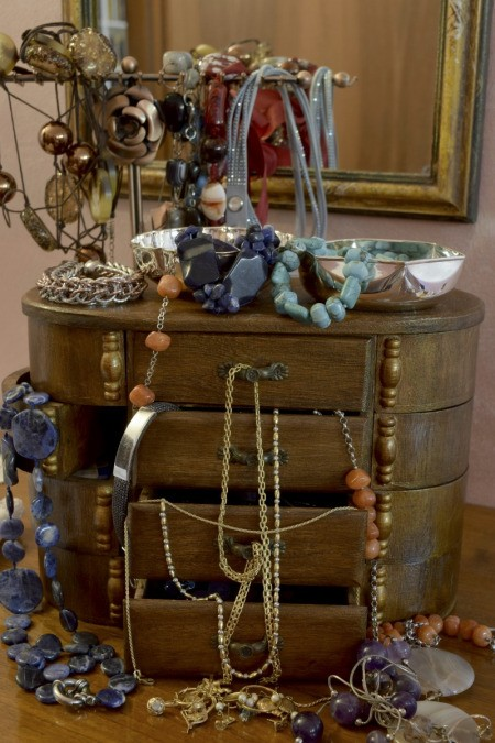 jewelry box with drawers overflowing with jewelry