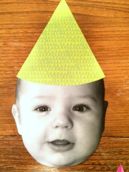 Baby Faces Birthday Banner - hat on face