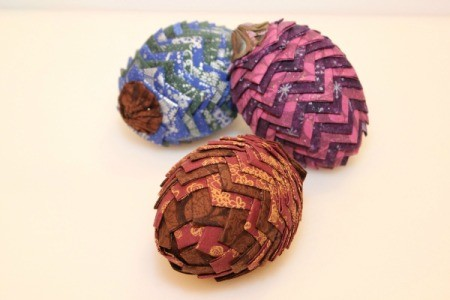 three fabric pinecone decorations