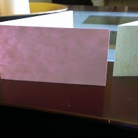different colors of folded paper strips
