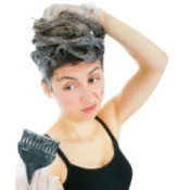 Woman Fixing Hair Color