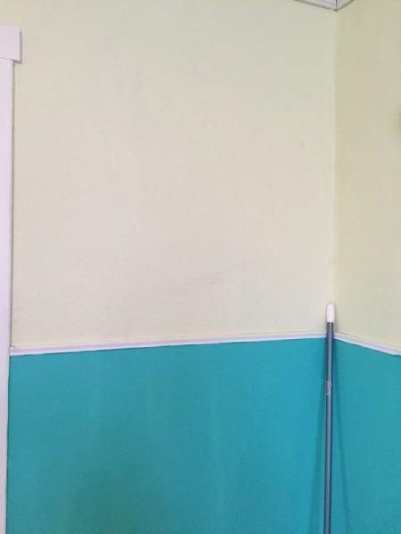walls with off yellow on top and blue on bottom