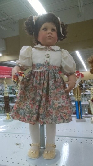 doll in floral dress with white top