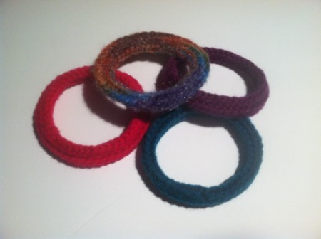 bangles arrayed on white surface