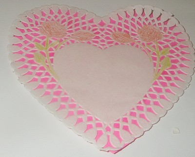 doily with pink paper heart behind