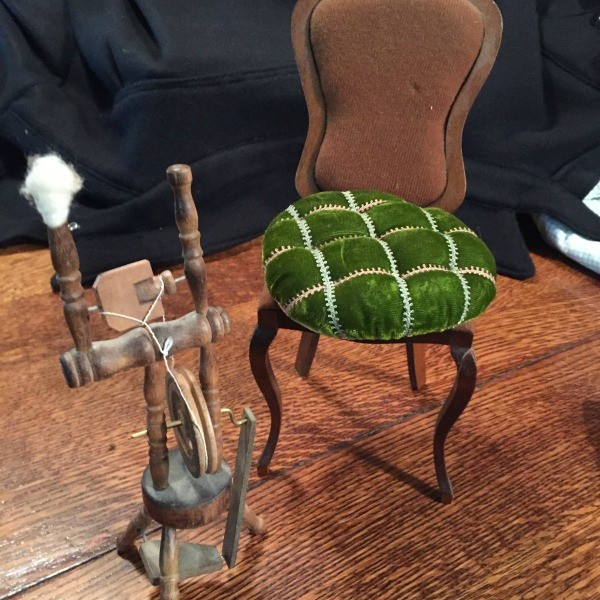 chair and spinning wheel