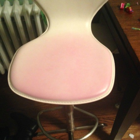 pink stain on white leather seat