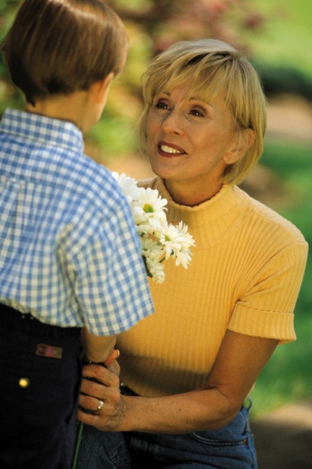 Grandchild Giving Flowers to Grandmother Gratitude
