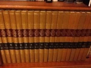 brown volumes on shelf