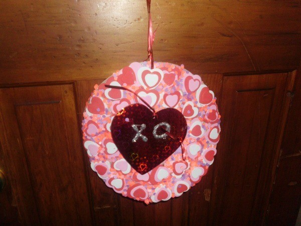 paper wreath with paper hearts glued on